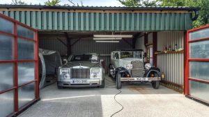 Bramwith and Rolls Royce on display in garage having maintenance work custom built vehicles.