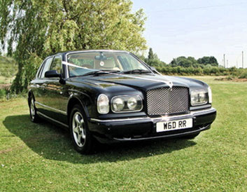 Rolls Royce ghost on grass from distance wedding car executive hire