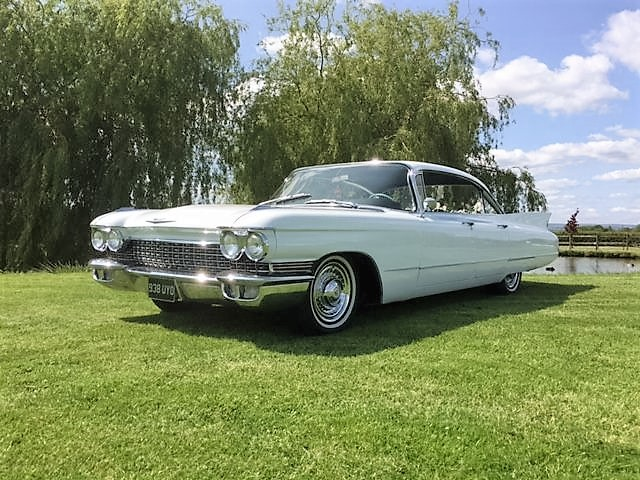 1960 baby blue cadillac on display in field for customers