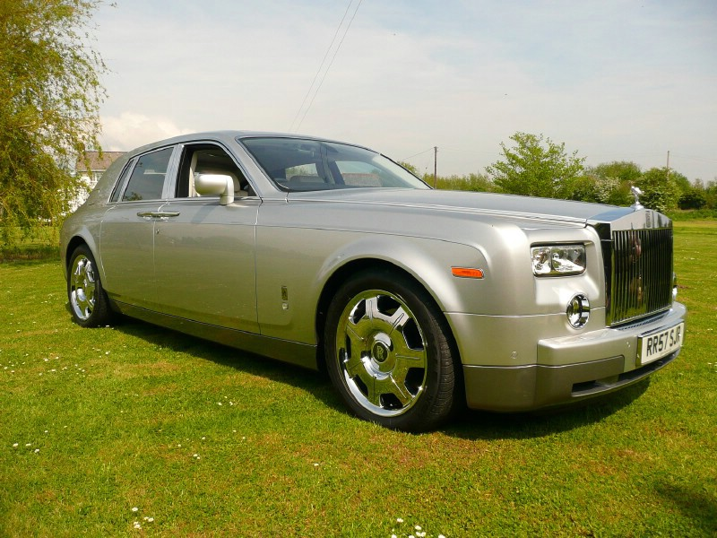 rolls royce ghost silver executive car in display field