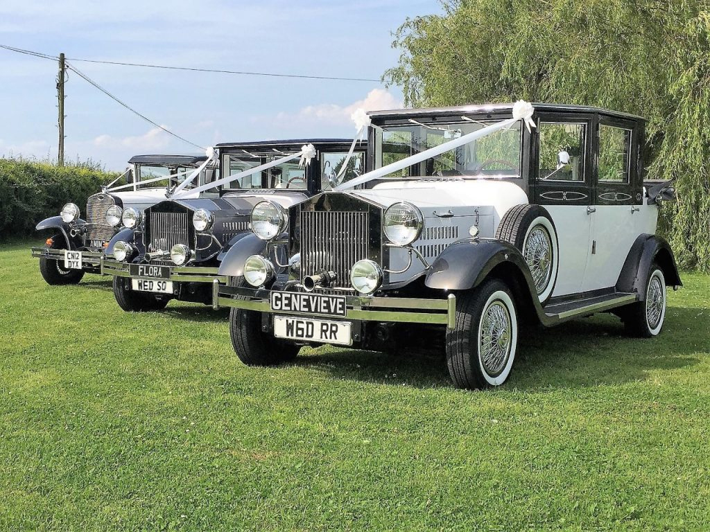3 vintage and classical cars, wedding cars, with bows and sashs