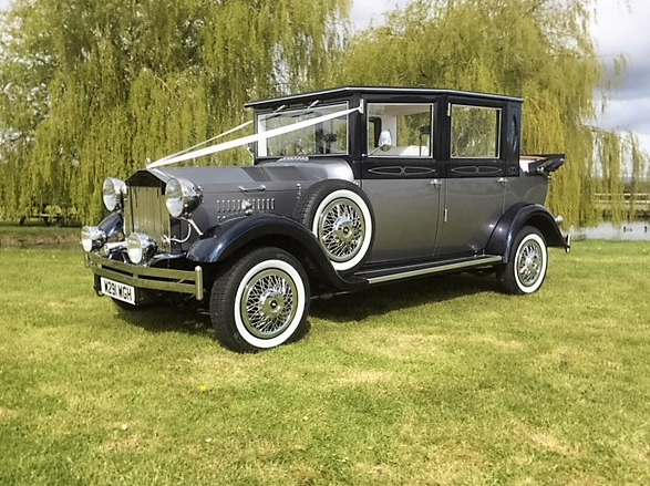 Viscount Vintage custom built car for wedding hire with bows and ribbons